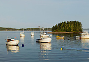 A man rows to his lobster boat in Beals Island, Maine.