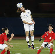 Ian Quillinan (5) heads the ball away from Maximilian Heffron, left, and Oliver Muran of Friends Academy during a Class C state semifinal boys' soccer game at Faller Field in  Middletown on Saturday, Nov. 16, 2013.
