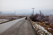 A resident of Rankovce is walking with his children the road to the neigbouring village of Kecerovce. The foundation ETP Slovakia has a project in Rankovce setting up micro-loan funds for the local Roma community. Loans from this fund will enable families to build their own low-cost brick homes, on land they own.