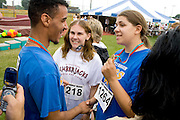Athletes showing medal and shaking hands. Special Olympics U of M Bierman Athletic Complex. Minneapolis Minnesota USA
