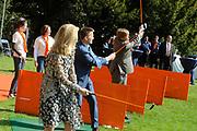 KONINGINNEDAG 2009 in Apeldoorn / Queensday 2009 in the city of Apeldoorn.<br /> <br /> Op de foto / On the Photo:<br />  Princes Mabel , Pieter Christiaan and Willem Alexander Playing Golf