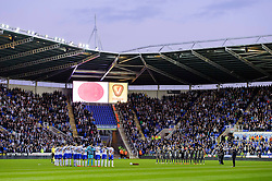 The players stand for a minutes silence before the match to mark the 25th anniversary of the Hillsborough disaster - Photo mandatory by-line: Rogan Thomson/JMP - 07966 386802 - 14/04/2014 - SPORT - FOOTBALL - Madejski Stadium, Reading - Reading v Leicester City - Sky Bet Football League Championship.