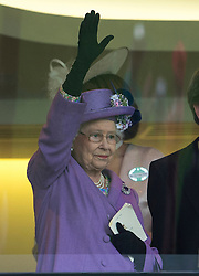 HM The Queen smiles in the Royal Box after winning the Gold Cup with her horse Estimate in the Royal Box at Royal Ascot 2013,<br /> Ascot, United Kingdom,<br /> Thursday, 20th June 2013<br /> Picture by i-Images