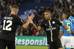 PSG's Kylian Mbappe and Thomas Meunier joy after an own goal by Naples's Mario Rui gave a 1-1 goal for PSG during the Group stage of the Champion's League, Paris-St-Germain vs Napoli in Parc des Princes, Paris, France, on October 24th, 2018. PSG and Napoli drew 2-2. Photo by Henri Szwarc/ABACAPRESS.COM
