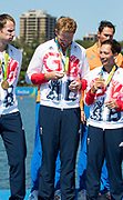 "Rio de Janeiro. BRAZIL. Will SATCH, check out his medal. GBR W8+ Silver Medalist, awards dock. 2016 Olympic Rowing Regatta. Lagoa Stadium,<br /> Copacabana,  ""Olympic Summer Games""<br /> Rodrigo de Freitas Lagoon, Lagoa.   Saturday  13/08/2016 <br /> <br /> [Mandatory Credit; Peter SPURRIER/Intersport Images]"