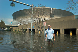 30 August, 2005. New Orleans Louisiana.  Hurricane Katrina aftermath. <br /> Daily Mirror reporter Ryan Parry wades through flood water at the Superdome in New Orleans.<br /> Photo Credit: Charlie Varley/varleypix.com