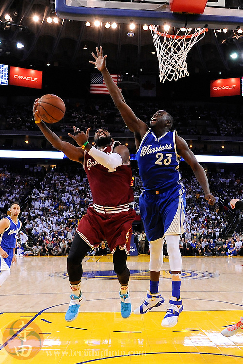 December 25, 2015; Oakland, CA, USA; Cleveland Cavaliers guard Kyrie Irving (2, left) shoots the basketball against Golden State Warriors forward Draymond Green (23) during the fourth quarter in a NBA basketball game on Christmas at Oracle Arena. The Warriors defeated the Cavaliers 89-83.