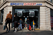 Groups of shoppers leave a branch of British high street sports goods and fashion retailer Sports Direct on 2nd September, 2021 in Leeds, United Kingdom. Sports Direct International plc is the UKs largest sports-goods retailer with around 670 branches across the world.