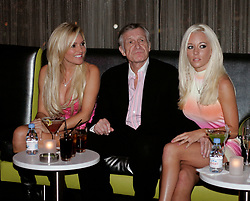 Playmates Bridget Marquardt and Kendra Wilkinson pose with Hugh Hefner at the palms Hoterl Casino Ghost Bar fashon show to introduce the new Bunny suits for the Las Vegas Playboy Cllub opening in the Fantacy Tower of the Palms Casino Las Vegas rings in 2018 with fireworks from the top of the Stratosphere