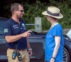 The Princess Royal talks to her son Peter Phillips at the Festival of British Eventing at Gatcombe Park, Gloucestershire.