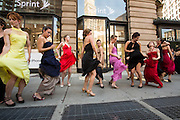 The women break into jazzy dance steps beside the Flatiron Building.