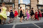 The women break into jazzy dance steps beside the Flatiron Building.