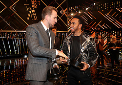 Third placed Harry Kane (left) and Second placed Lewis Hamilton shake hands after the BBC Sports Personality of the Year award during the BBC Sports Personality of the Year 2018 at Birmingham Genting Arena.