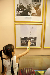 Young Girl Pointing To Plane SHot Down Over Hanoi Dec. 1972