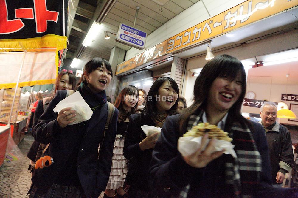 Japanese school girls having fun during Torino no Ichi