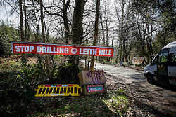 © Licensed to London News Pictures. 02/03/2017. Coldharbour, UK. A sign near the 'Protection Camp' on Leith Hill says 'STOP DRILLING @ LEITH HILL' . Activists have constructed and occupied a fort and some trees on the site of a proposed oil well. Planning permission for 18 weeks of exploratory drilling was granted to Europa Oil and Gas in August 2015 after a four-year planning battle. The camp was set up by protestors in October 2016 in order to draw  attention to plans to drill in this Area of Outstanding Natural Beauty (AONB) in the Surrey Hills. The camp has received support from the local community.  Photo credit: Peter Macdiarmid/LNP