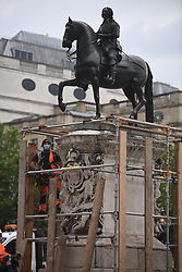 © Licensed to London News Pictures. 12/06/2020. London, UK. A statue of Charles 1st next to Trafalgar Square being boarded up during a Black Lives Matter demonstration In central London. Black Lives Matter have called for the removal of statues from throughout the UK of historical characters involved in the slave trade, following the death of George Floyd in the U. S. A. Photo credit: Ben Cawthra/LNP