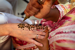 Guests have their hands decorated with henna at the wedding of  Meryem Benanine, 32, and Nabil Abou et Ainine, 33, who were married in a traditional ceremony arranged by their families in Casablanca, Morocco on May 10, 2009.