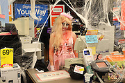 Anastasia H. dressed as Zombie Princess Peach for Halloween at the CVS Pharmacy photo department in Carrboro, North Carolina.