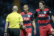Karl Henry (QPR) and Gabriele Angella (QPR) talk to Andy Davies (referee) about the awarding of the penalty to Sheffield Wednesday during the Sky Bet Championship match between Sheffield Wednesday and Queens Park Rangers at Hillsborough, Sheffield, England on 23 February 2016. Photo by Mark P Doherty.