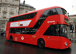 © Licensed to London News Pictures. 16/12/2011, London, UK.  The first bus designed specifically for London arrived in the capital today, carrying the Mayor of London BORIS JOHNSON. The bus design is based on the famous red route master buses with a rear platform for access. Photo credit : Stephen Simpson/LNP