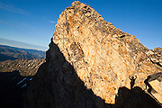 A hiker's shadow projected onto a rock buttress, celebrates on a climb of Golden Horn, Okanogan National Forest, Washington.