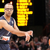 15 July 2012: Tony Parker of Team France passes the ball during a pre-Olympic exhibition game won 75-70 by Spain over France, at the Palais Omnisports de Paris Bercy, in Paris, France.