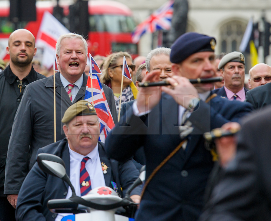 © Licensed to London News Pictures. <br /> 14/4/2017. London, Great Britain. <br /> Col Bob Stewart MP former Cheshire Regiment during the Justice for Northern Ireland Veterans March in central London.<br /> They are protesting the prosecution of former Service men and women who served in Northern Ireland during the Troubles.<br /> Photo credit: Anthony Upton/LNP