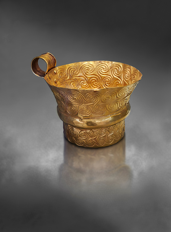 Mycenaean gold cup with spiral decorations, Grave V, Grave Circle A,  Mycenae, Greece. National Archaeological Museum of Athens.   Grey Art Background<br /> <br /> An elegant precious gold cup hammered from thick gold to created a simple elegant design. This Mycenaean gold cup demonstrates how advance Mycenaean metalworking was in the 16th century BC. The value of the cup would have been extermely high so must have graced the table of a Mycenaean noble perhaps even a v king. .<br /> <br /> If you prefer to buy from our ALAMY PHOTO LIBRARY  Collection visit : https://www.alamy.com/portfolio/paul-williams-funkystock/mycenaean-art-artefacts.html . Type -   Athens    - into the LOWER SEARCH WITHIN GALLERY box. Refine search by adding background colour, place, museum etc<br /> <br /> Visit our MYCENAEN ART PHOTO COLLECTIONS for more photos to download  as wall art prints https://funkystock.photoshelter.com/gallery-collection/Pictures-Images-of-Ancient-Mycenaean-Art-Artefacts-Archaeology-Sites/C0000xRC5WLQcbhQ