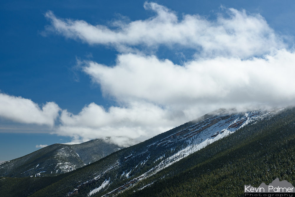 Clouds swirl around the Bighorn Mountains near Sand Turn Overlook after a late season snowfall.