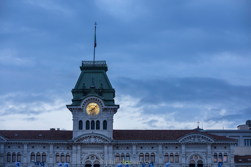 Low angle view of Trieste Town Hall at dusk, Trieste, Italy