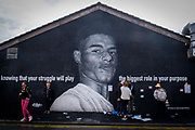 The Marcus Rashford mural displayed on the side of a cafe in Withington, south Manchester on the 6th of August 2021, Manchester, United Kingdom.  The mural has attracted huge numbers of people since the Euro 2020 final between England and Italy on 11 July and the subsequent racist abuse levied at Rashford and other black players on the England team. Based on a photograph by Daniel Cheetham, the painting of Marcus Rashford was completed in 2020 by street artist Akse, in collaboration with the street art project Withington Walls, to commemorate the footballers work to reduce child hunger.
