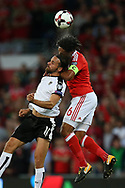 Ashley Williams of Wales (r) jumps for a header with Martin Harnik of Austria. Wales v Austria , FIFA World Cup qualifier , European group D match at the Cardiff city Stadium in Cardiff , South Wales on Saturday 2nd September 2017. pic by Andrew Orchard, Andrew Orchard sports photography