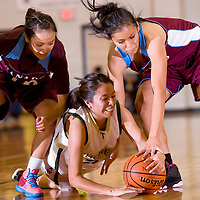 121312       Cable Hoover<br /> <br /> Thoreu Hawk Chelsey Yazzie (21) and Ganado Hornets Nicole Curley (5) and Arianna Chee (10) chase after a loose ball Thursday at Wingate High School.