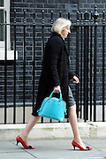 © Licensed to London News Pictures. 21/03/2012. Westminster, UK. The Home Secretary, Theresa May, on Downing Street on the day of the budget on March 21, 2012. The Chancellor is expected to raise the amount of money people can earn before income tax takes hold and impose a new levy on the purchase of expensive homes. Photo credit : Stephen SImpson/LNP