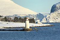 Lighthouse while Traveling to Alesund. Image taken with a Nikon D2xs and 80-400 mm VR lens (ISO 200, 400 mm, f/8.5, 1/320 sec).