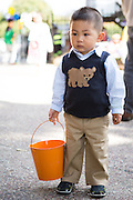Alvin Shen, 2, waits for the Easter Egg Hunt at Christ Community Church in Milpitas, California, on March 30, 2013. (Stan Olszewski/SOSKIphoto)