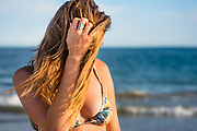 A young woman in a bikini enjoying a sunny day at the beach