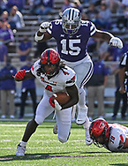 Running back SaRodorick Thompson #4 of the Texas Tech Red Raiders runs up field against pressure from behind by defensive back Walter Neil Jr. #15 of the Kansas State Wildcats during the first half at Bill Snyder Family Football Stadium on October 3, 2020 in Manhattan, Kansas.