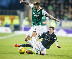 Falkirk's Conor McGrandles tackles Hibernian's Liam Fontaine.  <br /> Falkirk 1 v 1 Hibernian, Scottish Championship game played 17/1/2015 at The Falkirk Stadium.