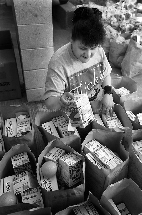 Volunteer packing food in bags for Second Harvest Food Bank.