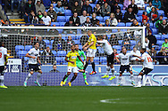 Brentfords' Jake Bidwell heads over the crossbar. Skybet football league championship match, Bolton Wanderers v Brentford at the Macron stadium in Bolton, Lancs on Saturday 25th October 2014.<br /> pic by Chris Stading, Andrew Orchard sports photography.