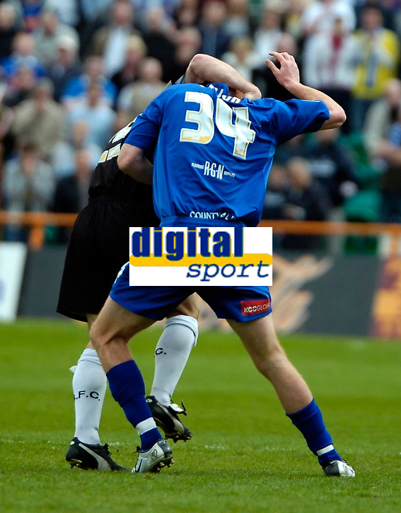 Photo: Ed Godden.<br />Barnet v Stockport County. Coca Cola League 2. 29/04/2006. Andy Hessenthaler (hidden) and Jason Taylor (34) of Stockport, have an off-the-ball disagreement.
