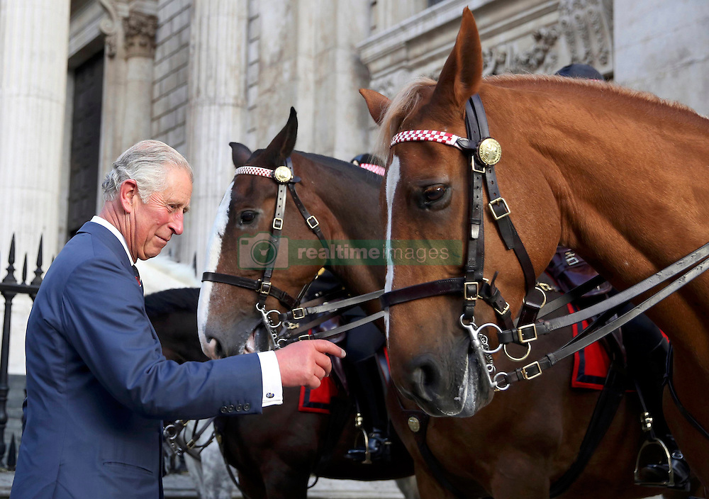 The Prince of Wales meets mounted police officers and their horses after the service to commemorate National Police Memorial Day at St Paul's Cathedral in central London.