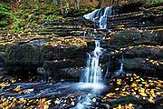 Autumn waterfall at Beecher Creek, Edinburg, New York, USA.