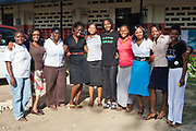 Lucy Yinda, the founder of Wema (2nd form left) and a group of ex beneficiary outside the Wema centre in Mombassa, Kenya. Wema provide a rehabilitation program for street children; poor, disadvantaged youth; and, orphaned and vulnerable children affected by poverty. Emotional support and education enables the children reintegration back into society.