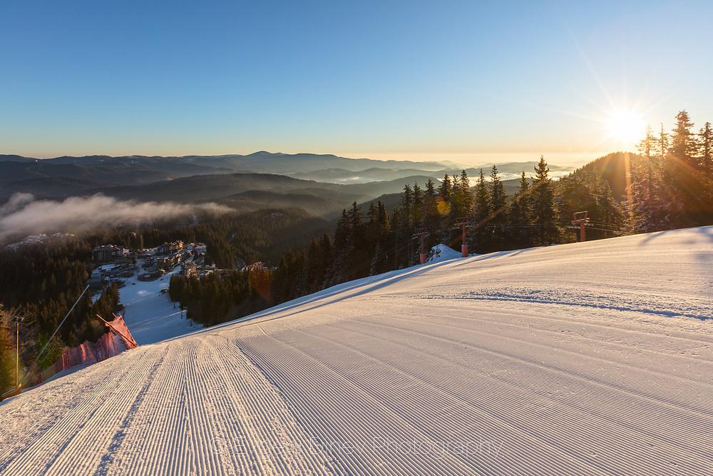 Steep ski run in winter morning