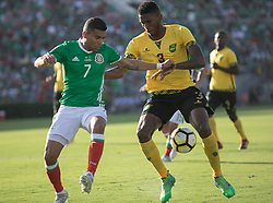 July 23, 2017 - Pasadena, California, U.S - Orbelin Pineda #7 of Mexico and Damion Lowe #3 of Jamaica battle for the ball during their Gold Cup Semifinal game at the Rose Bowl in Pasadena, California on Sunday July 23, 2017. Jamaica defeats Mexico, 1-0. (Credit Image: © Prensa Internacional via ZUMA Wire)