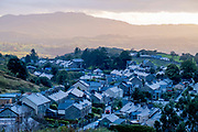 An aerial view of houses in the industrial town of Blaenau Ffestiniog, on 3rd October 2021, in Blaenau Ffestiniog, Gwynedd, Wales. The derelict slate mines around Blaenau Ffestiniog in north Wales were awarded UNESCO World Heritage status in 2021. The industry's heyday was the 1890s when the Welsh slate industry employed approximately 17,000 workers, producing almost 500,000 tonnes of slate a year, around a third of all roofing slate used in the world in the late 19th century. Only 10% of slate was ever of good enough quality and the surrounding mountains now have slate waste and the ruined remains of machinery, workshops and shelters have changed the landscape for square miles.