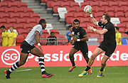 New Zealand's Tim Mikkelson throws an overhead pass during the HSBC Singapore Rugby Sevens Cup Quarter Final - Fiji v New Zealand   won by Fiji 19-5 at The National Stadium, Singapore, Sunday, April 14th, 2019. (Steve Flynn/Image of Sport)